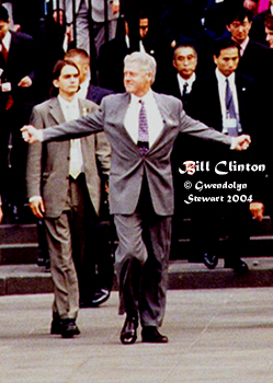 Photograph of President BILL CLINTON Emerging from the Cathedral at the 1999 G-8 Summit, Cologne, Germany, by GWENDOLYN STEWART c. 2009; All Rights Reserved