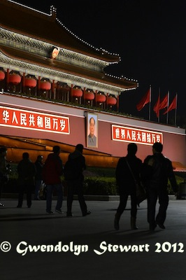 People Walk by the Tiananmen Portrait of Mao Zedong at Night,  Photographed by Gwendolyn Stewart c. 2013; All Rights Reserved